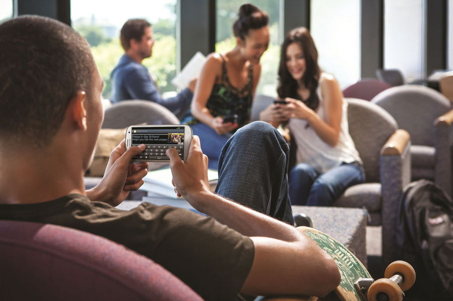 Young people use phones for online casinos